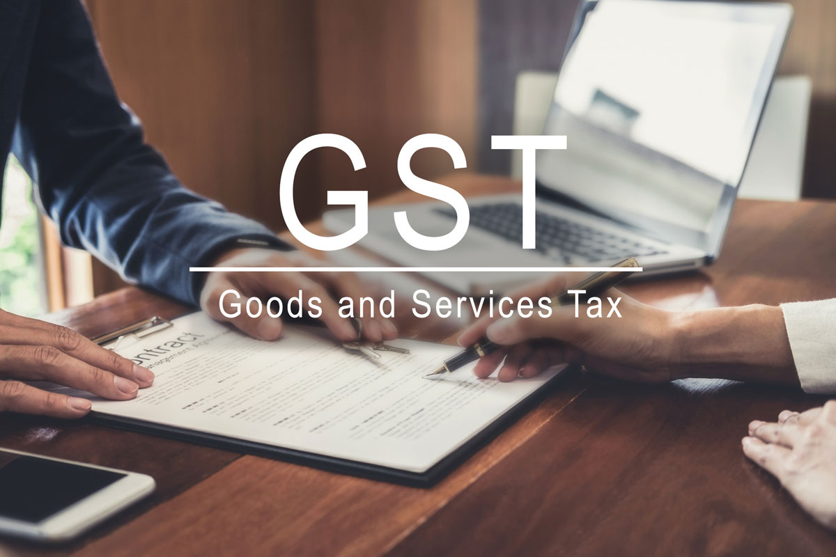 goods and services tax words overlaying signing of property sales considered part of exempt supplies under Singapore GST legislation