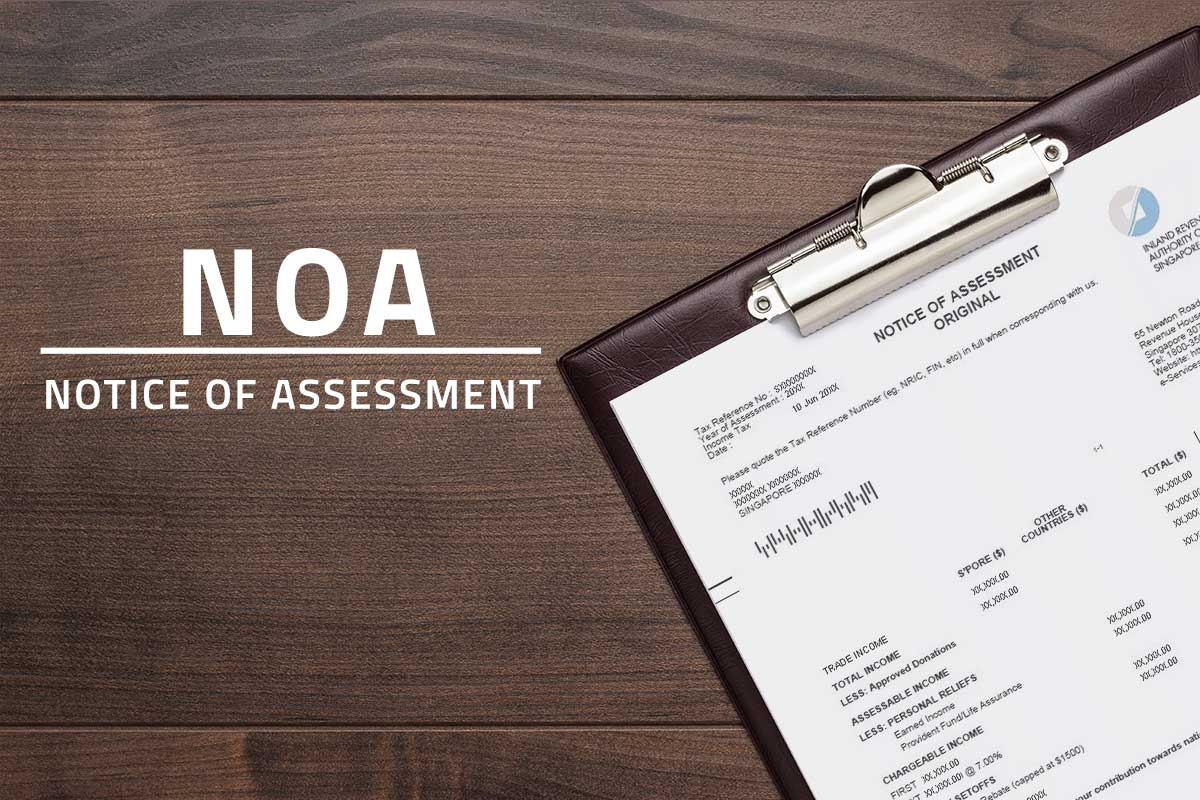 Large white text saying NOA Notice of Assessment against a background showing income tax bill attached on a clipboard resting atop a wooden table.