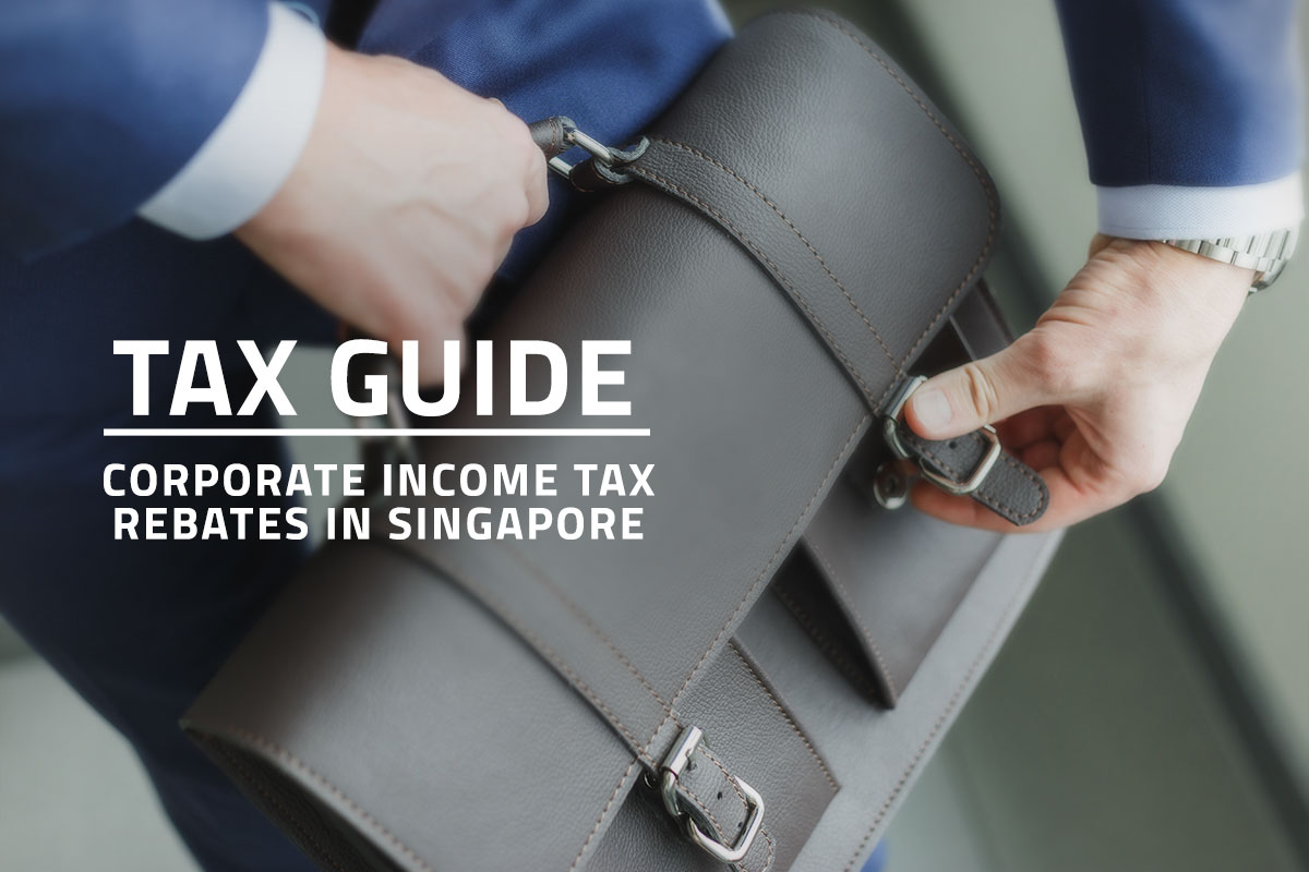 words tax guide corporate income tax rebates in singapore overlaying background closeup of a man in a suit carrying a company briefcase