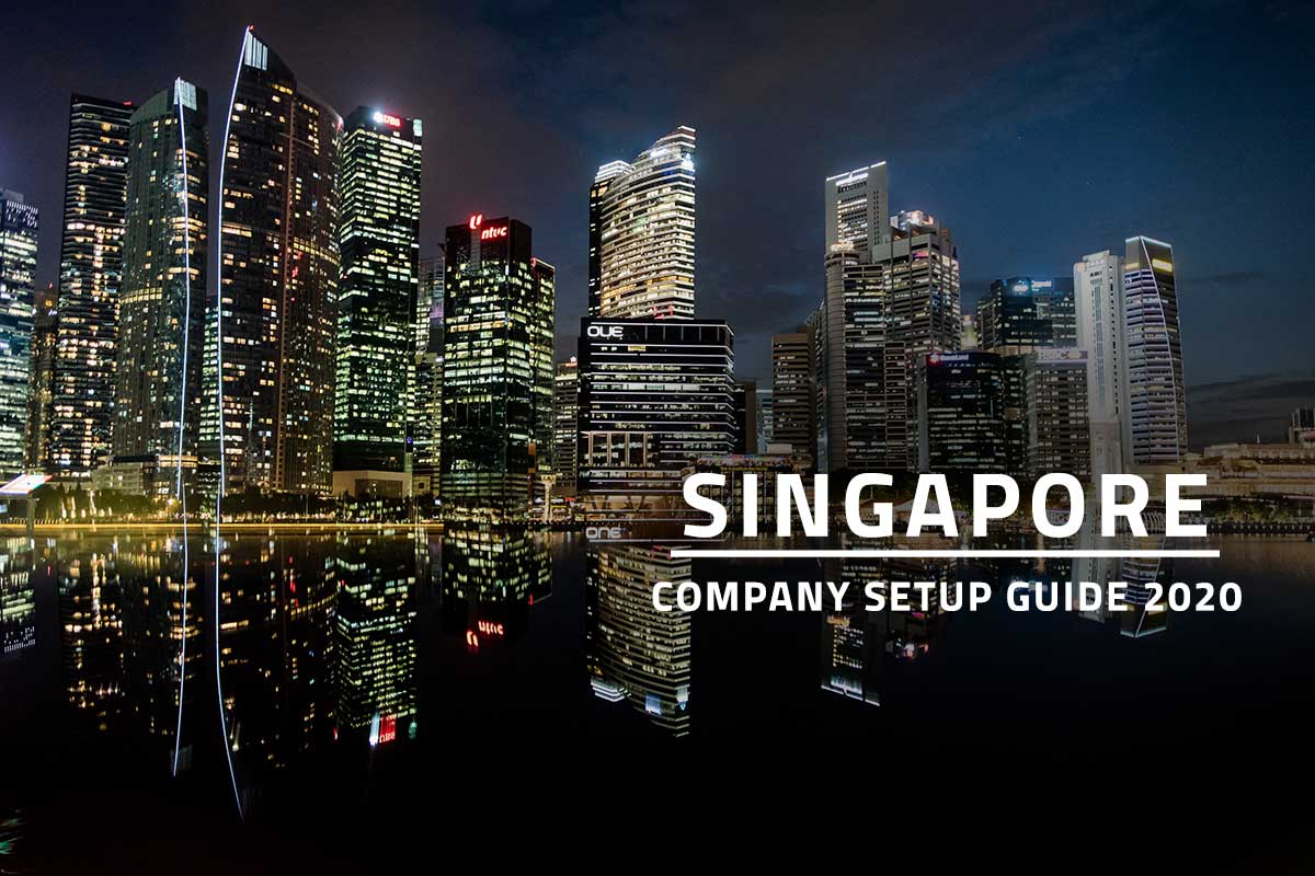 featured image for how to open a company in Singapore with white text Singapore company setup guide 2020 against background of Singapore cityscape at night