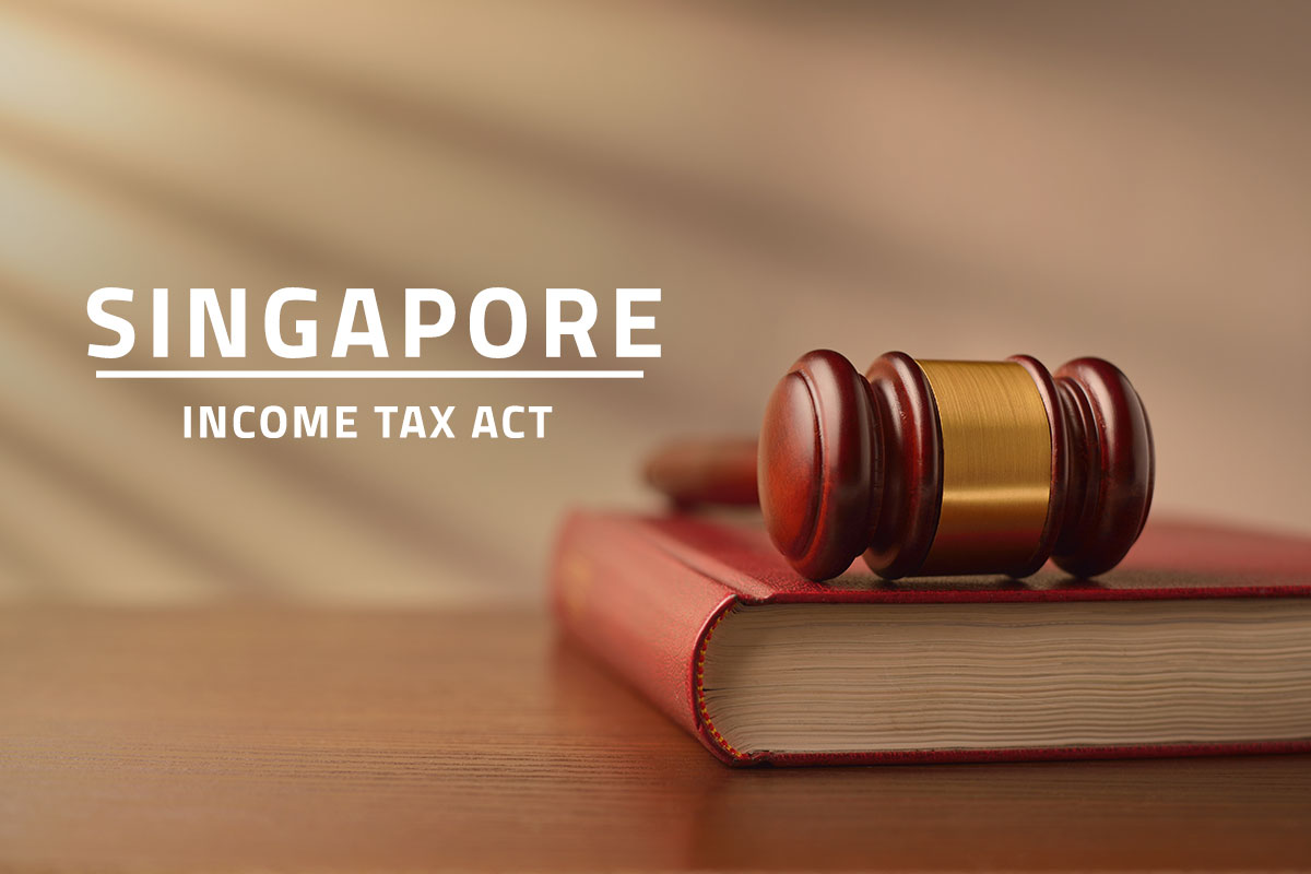 words Singapore income tax act over background of a table with a judge's gavel lying on top of a law book