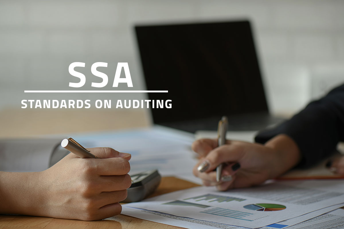 words SSA standards on auditing over background image of two accountants analysing audit reports on a desk with a computer