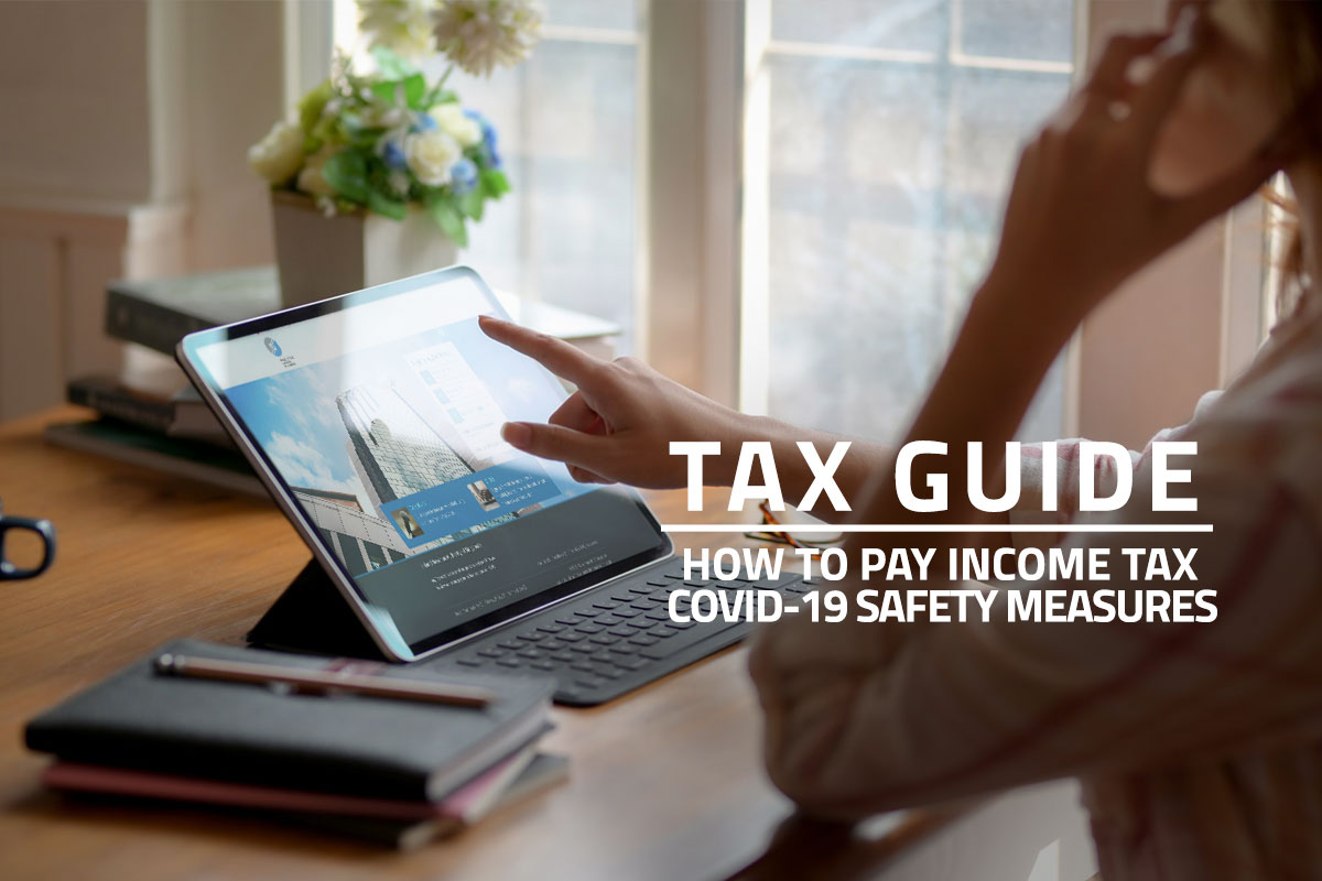 Words: Tax Guide How to Pay Income Tax COVID-19 Safety Measures over background of woman working at home and accessing the IRAS mytax portal online