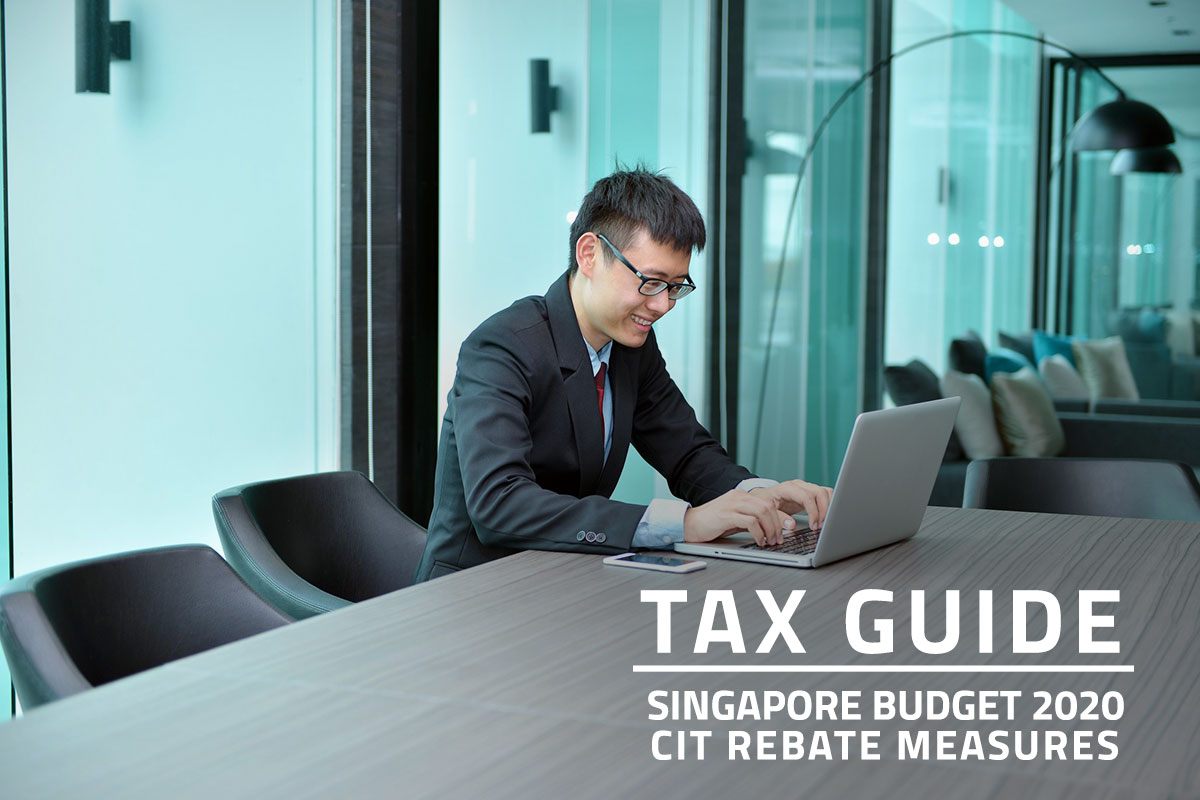 Words Tax Guide Singapore Budget 2020 Corporate Income Tax (CIT) Rebate Measures over background of an Asian man working on a laptop in an office meeting room