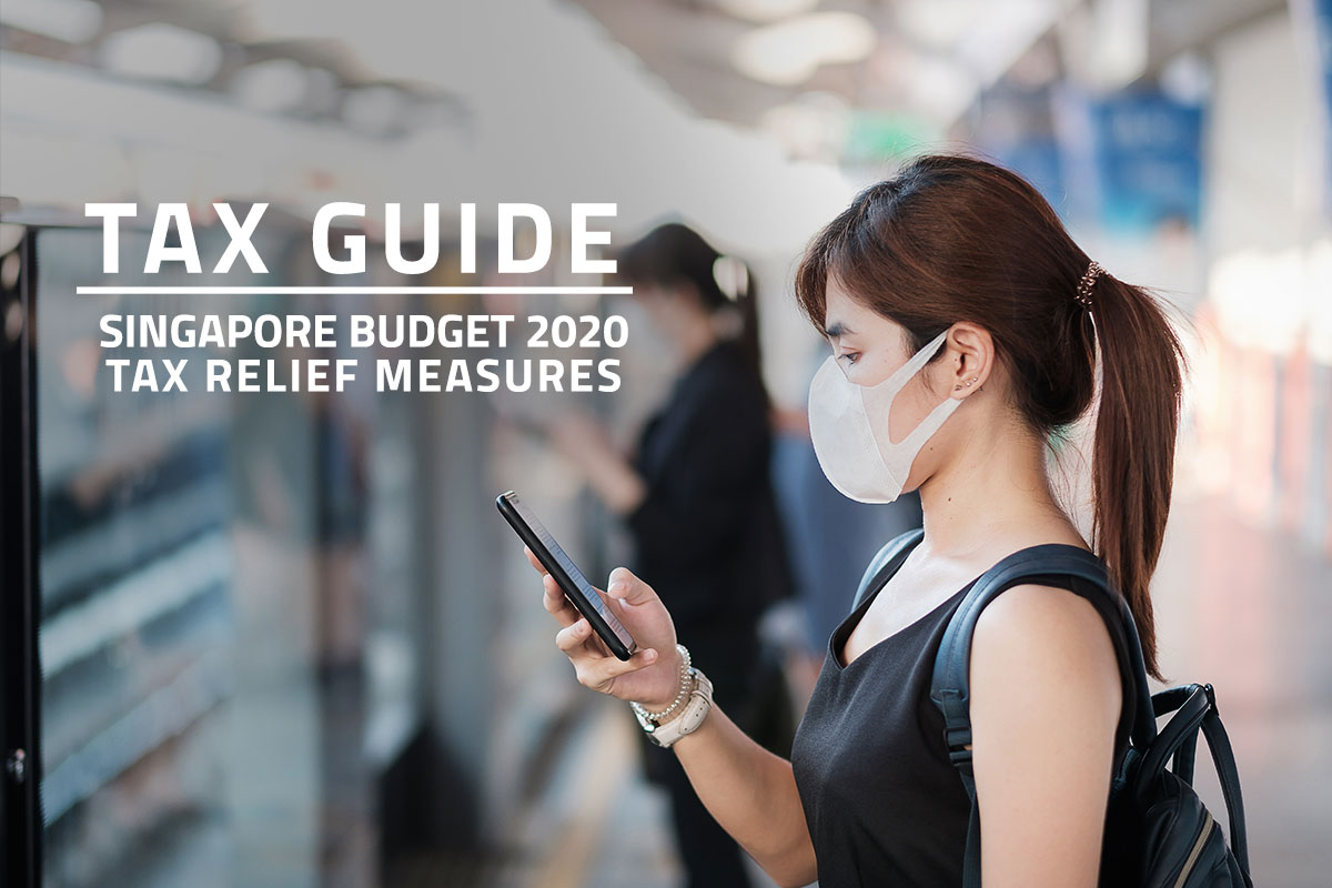 Words: Tax Guide Singapore Budget 2020 Tax Relief Measures over background of female Singapore worker wearing a face mask, looking at her mobile phone and waiting for the MRT to arrive