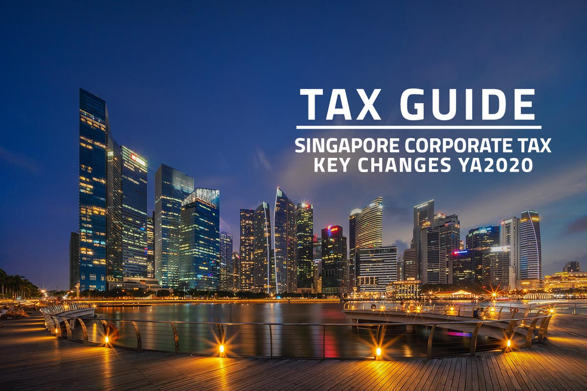 words tax guide Singapore corporate tax key changes ya2020 against background of Singapore financial district at night