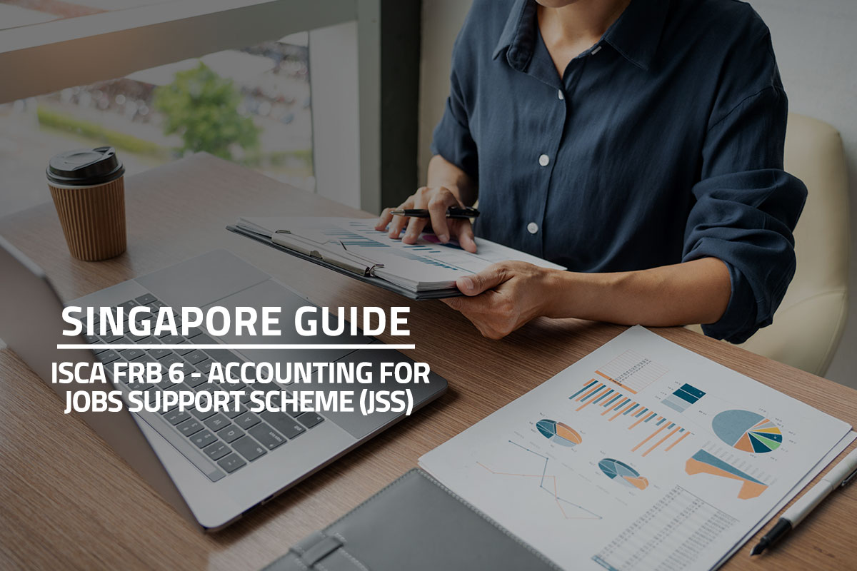 words singapore guide isca frb6 - accounting for jobs support scheme against background of a business man working with graph data in laptop and documents on his desk at office