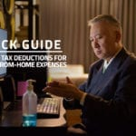 words quick guide income tax deductions for work-from-home expenses against background of asian businessman working with a computer at home
